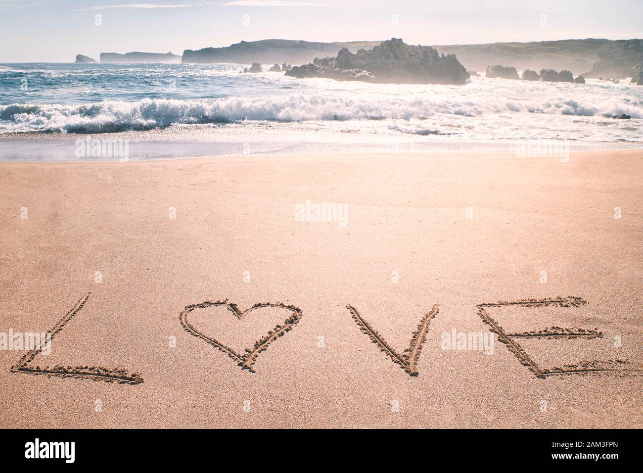 Love heart romantic beach. Summer holiday concept. Romantic love background. Valentine's Day theme. Copy space Stock Photo