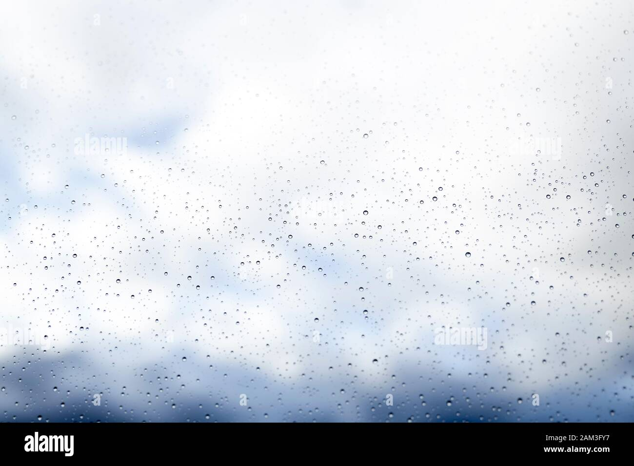 Glass texture with water drops on a rainy spring day. concept abstract background Stock Photo