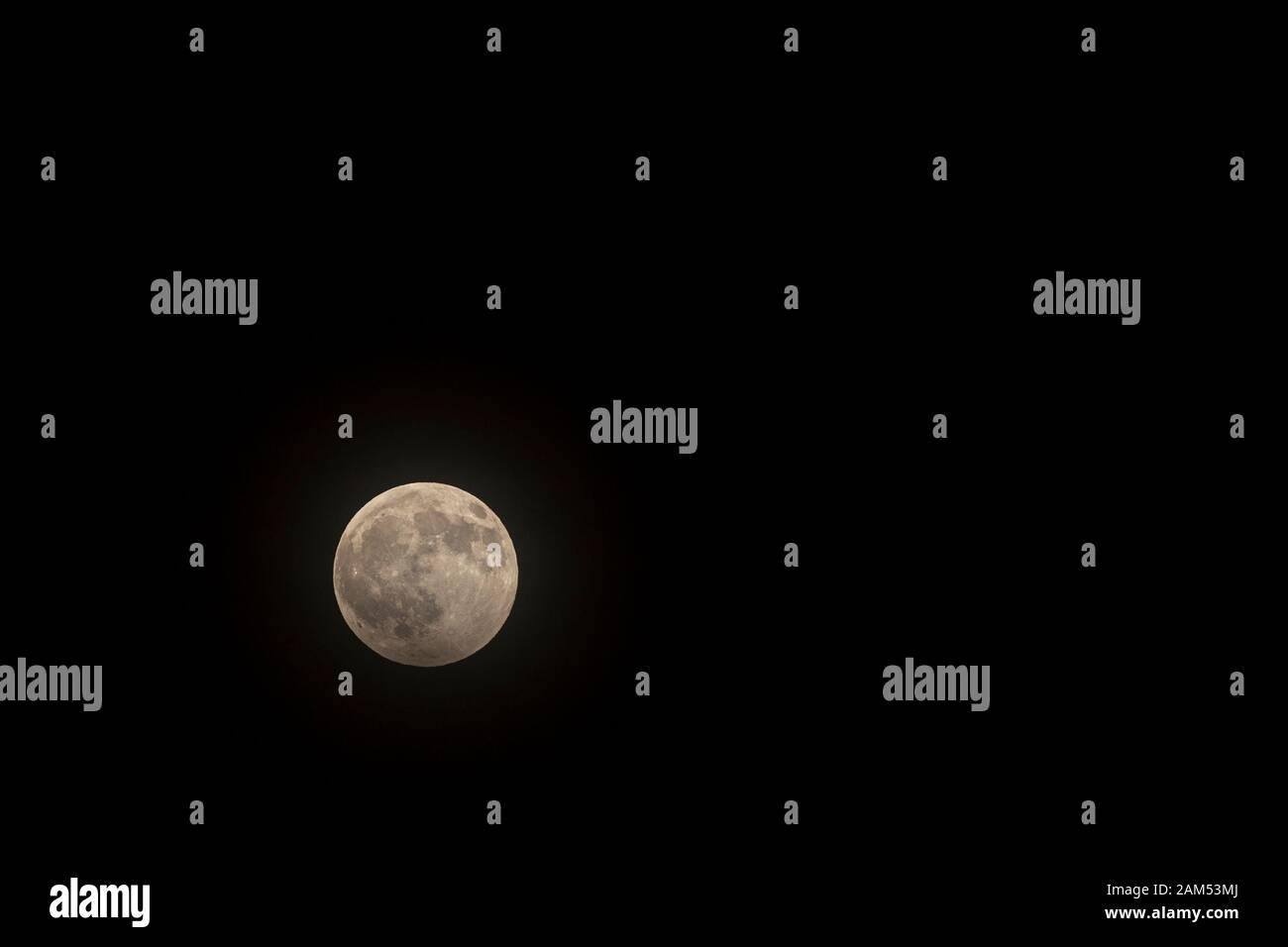 Full moon in the black night sky Stock Photo