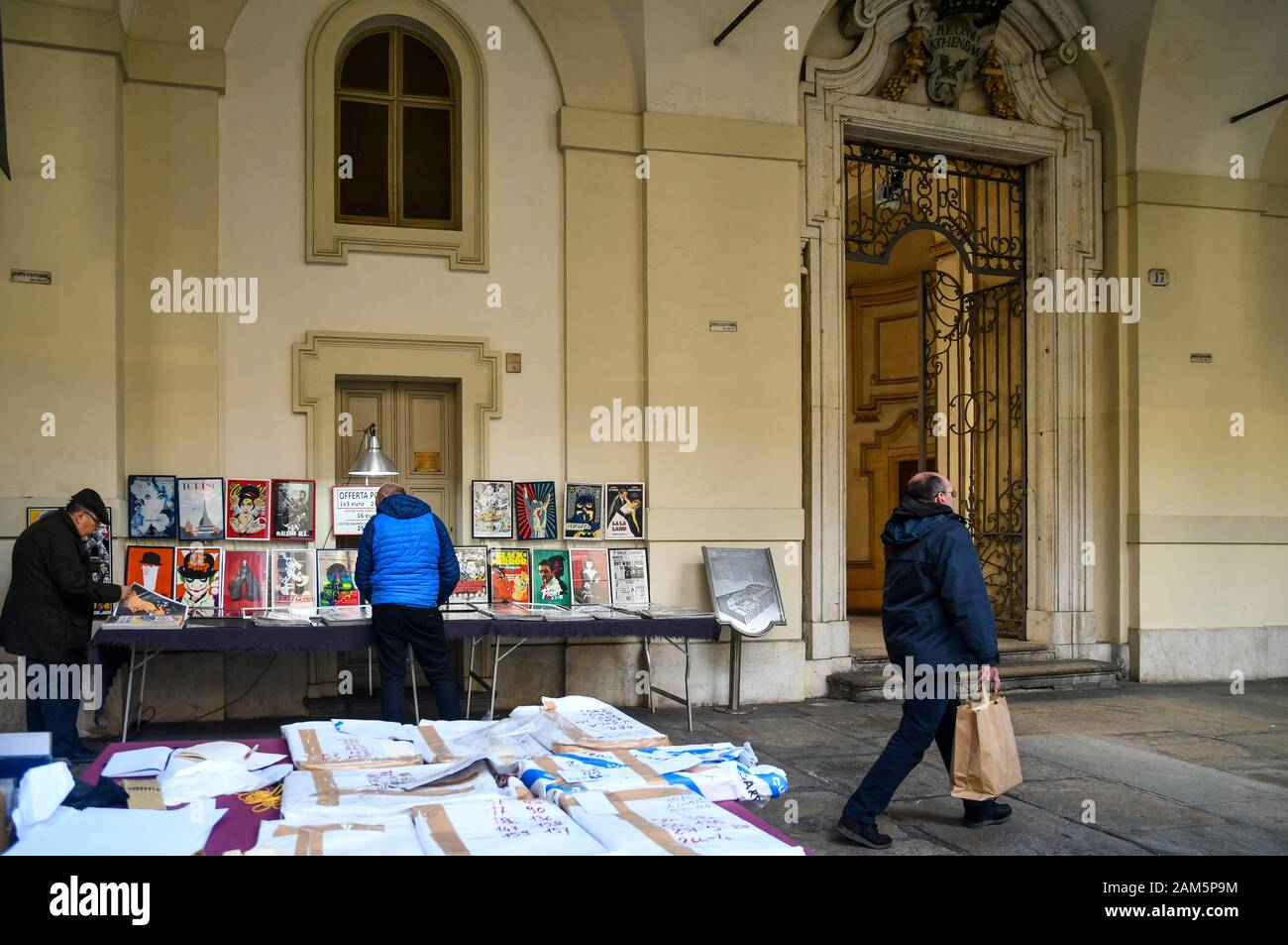 Glimpse of the second-hand book market in front of Rectorate Palace in the historic centre of Turin with people in a winter day, Piedmont, Italy Stock Photo
