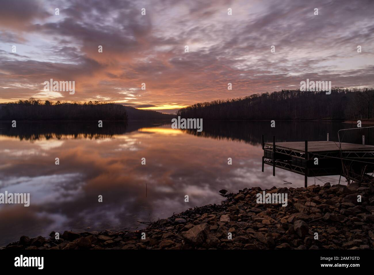 Sunrise Reflection - Lake Sidney Lanier. Beautiful December sunrise duplicated in the water's surface at Wahoo Creek Park. Sunrise Reflection - Lake S Stock Photo