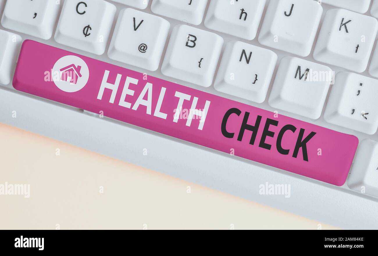 Writing note showing Health Check. Business concept for thorough physical examination A medical checkup of oneself White pc keyboard with note paper a Stock Photo