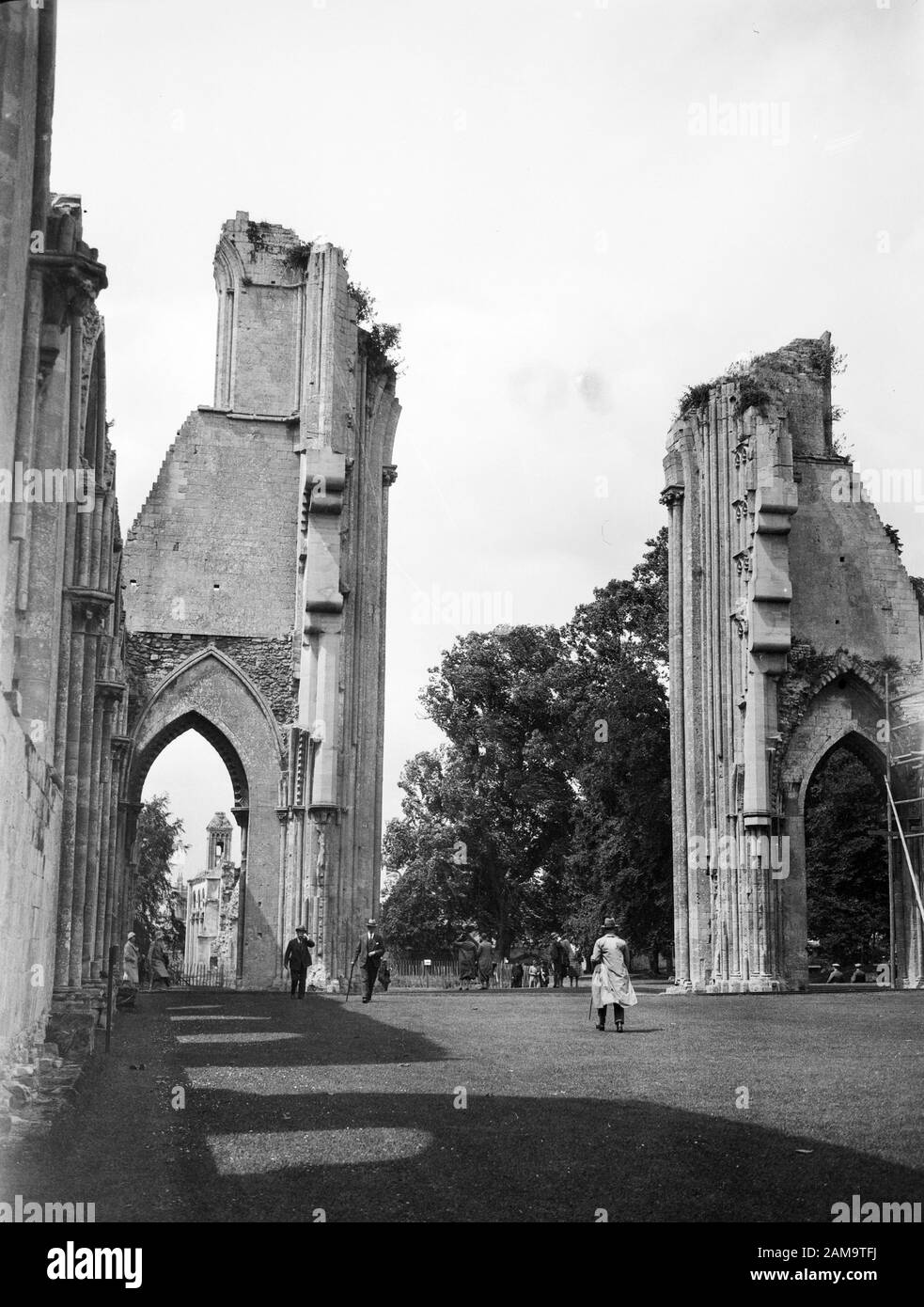 Archive image, circa 1920s, of visitors at Glastonbury Abbey, Somerset. Scanned from original glass negative. Stock Photo