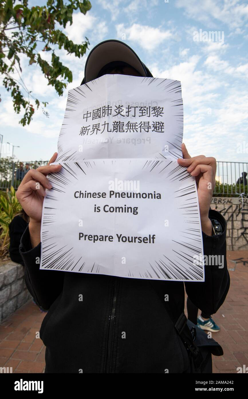 January 12 2020 Central Hong Kong. Karma to Commies Rally. A man holds a poster warning of the virus from China Stock Photo