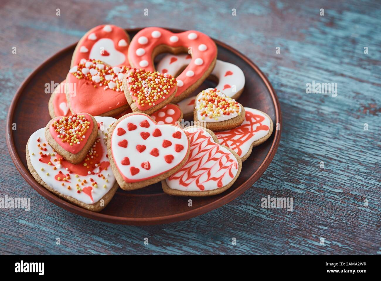 decorated shortbread cookies.htm decorated heart shape cookies in plate on gray background  decorated heart shape cookies in plate