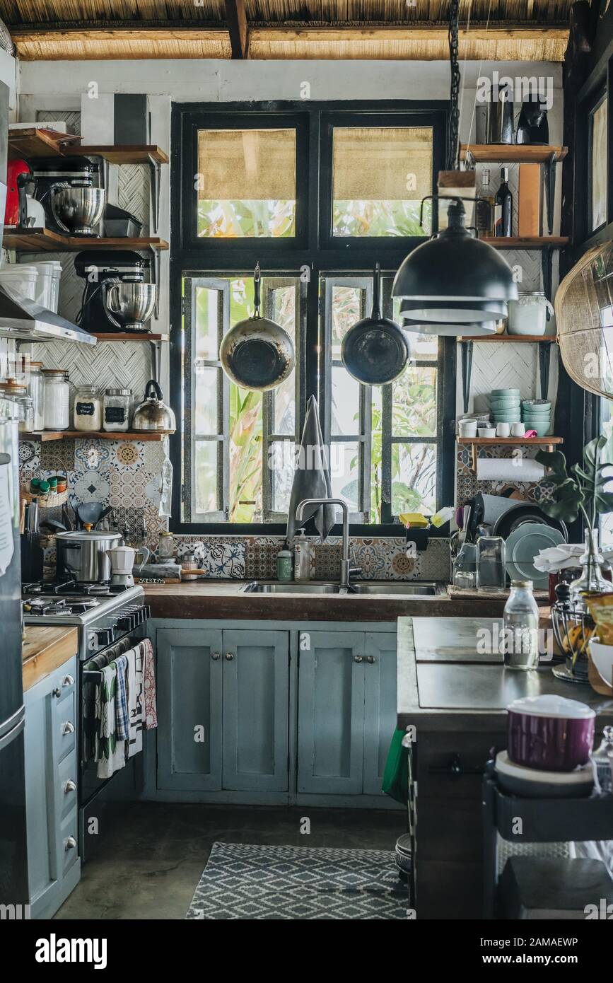 Old Crampy Rustic Kitchen With Small Window In A Tropical House With Straw Roof Stock Photo Alamy