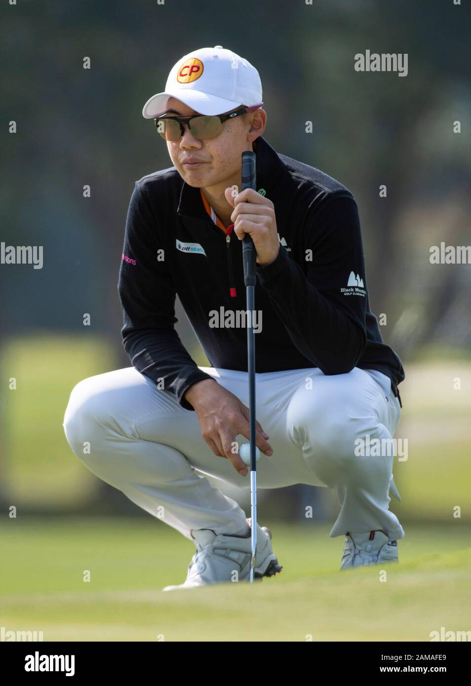 Fanling, Hong Kong, China. 12th Jan 2020.  61st Hong Kong Open Golf Final Round. Jazz Janewattananond of Thailand on the 3rd green. Credit: HKPhotoNews/Alamy Live News Stock Photo
