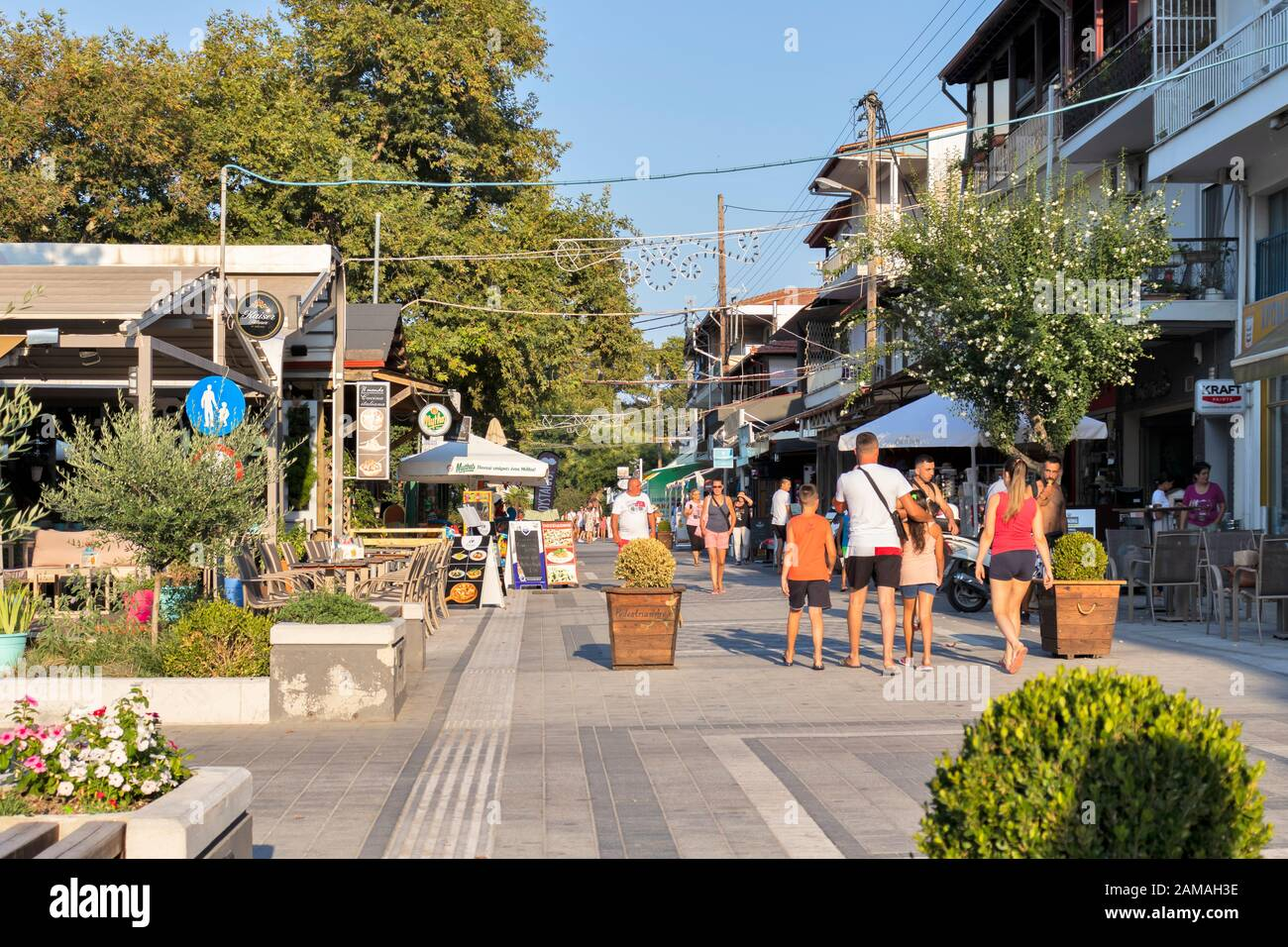 STAVROS, GREECE - AUGUST 19, 2019: Main pedestrian street of town of Stavros, Chalkidiki, Central Macedonia, Greece Stock Photo