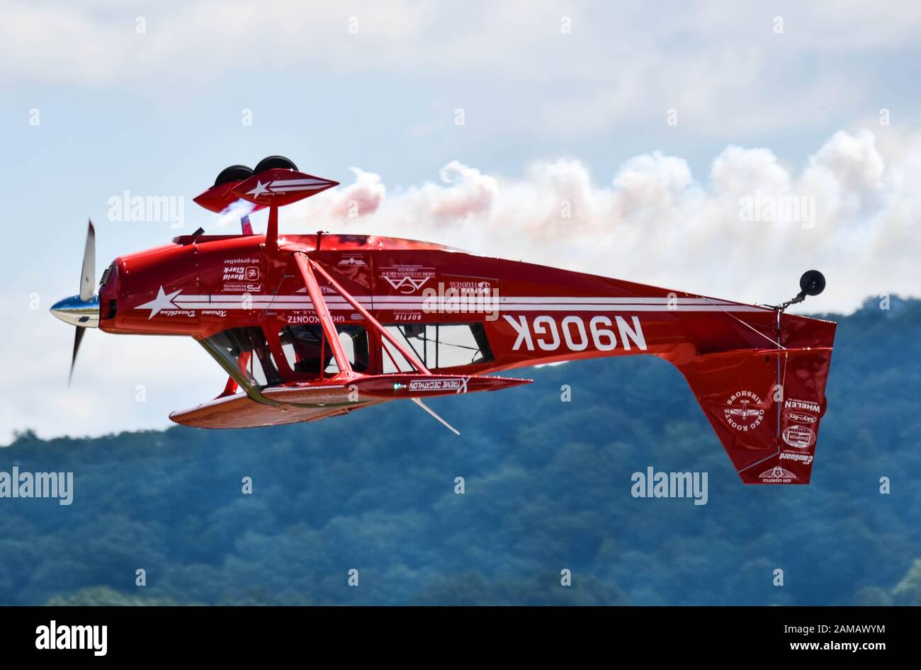 Single engine aircraft flying upside down Stock Photo