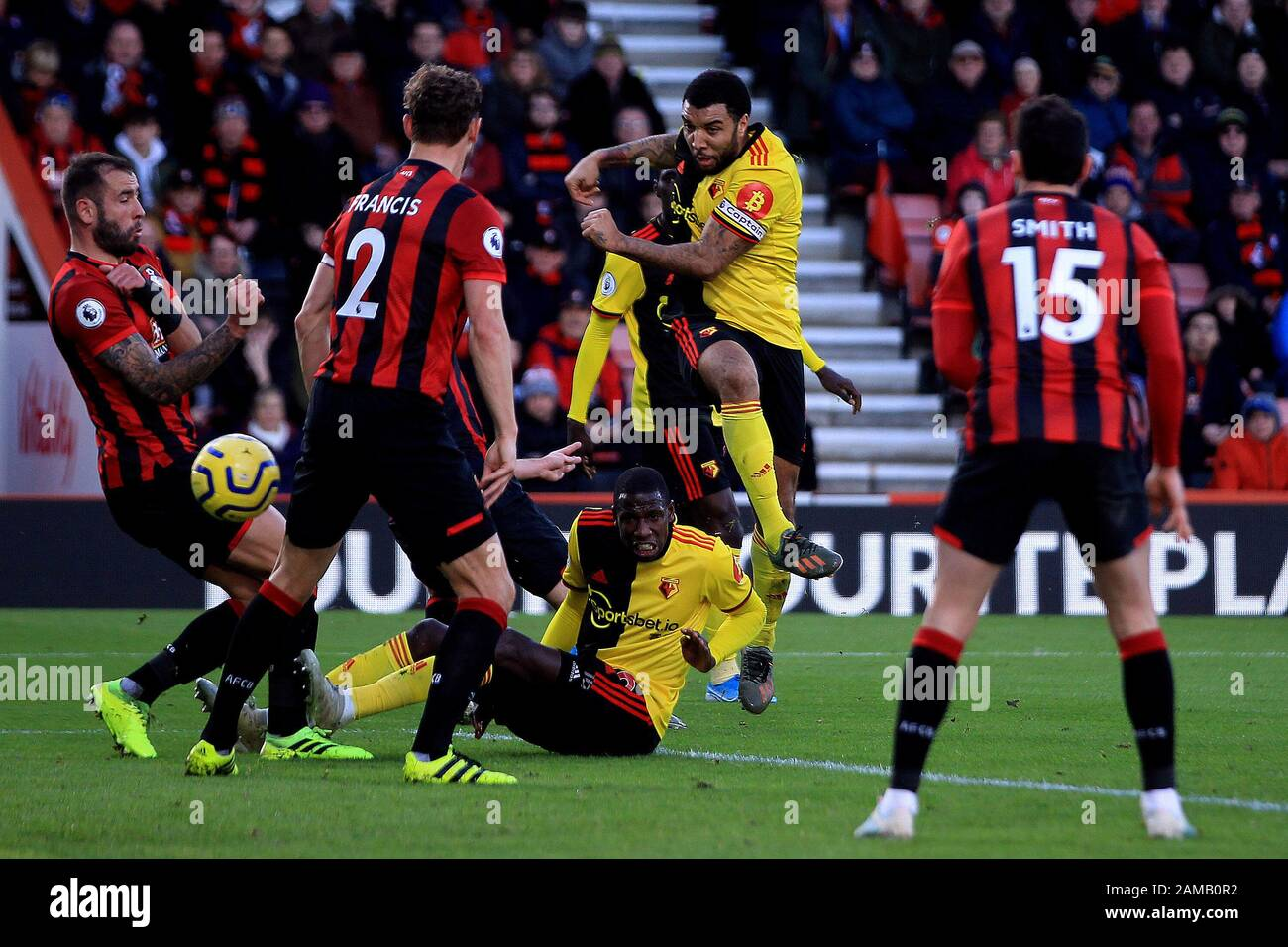 Bournemouth, UK. 12th Jan, 2020. Troy Deeney of Watford (c) shoots and scores his team's second goal. Premier League match, AFC Bournemouth v Watford at the Vitality Stadium in Bournemouth, Dorset on Sunday 12th January 2020. this image may only be used for Editorial purposes. Editorial use only, license required for commercial use. No use in betting, games or a single club/league/player publications. pic by Steffan Bowen/ Credit: Andrew Orchard sports photography/Alamy Live News Stock Photo