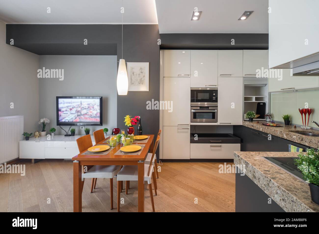 Modern Interior Of Kitchen In Studio Apartment Tv On The Wall Private House Stock Photo Alamy