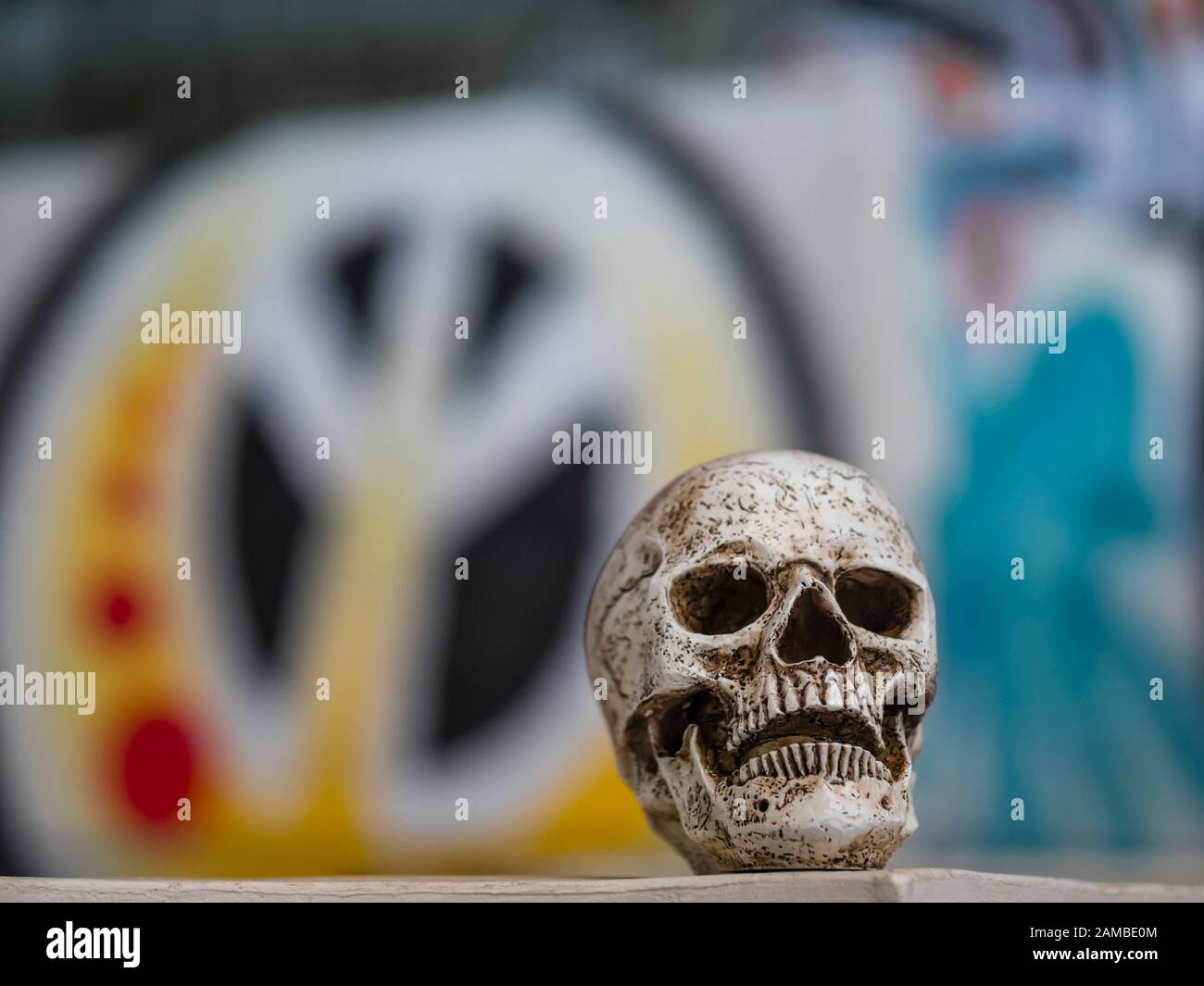 Human skull peace sign spray painted on background graffiti on wall Stock Photo