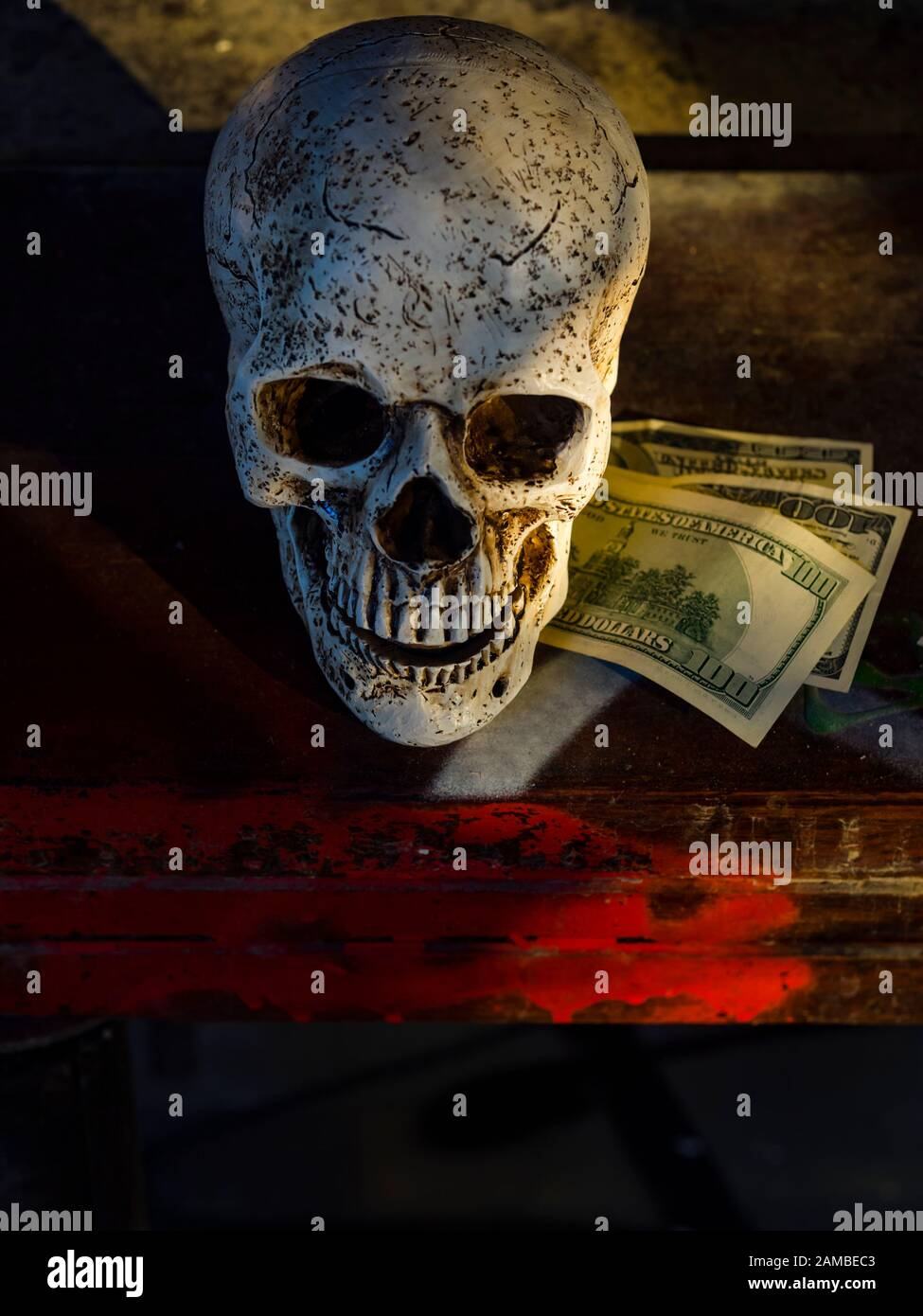 Human skull and dollars dirty Red blood money view from above table top tabletop Stock Photo