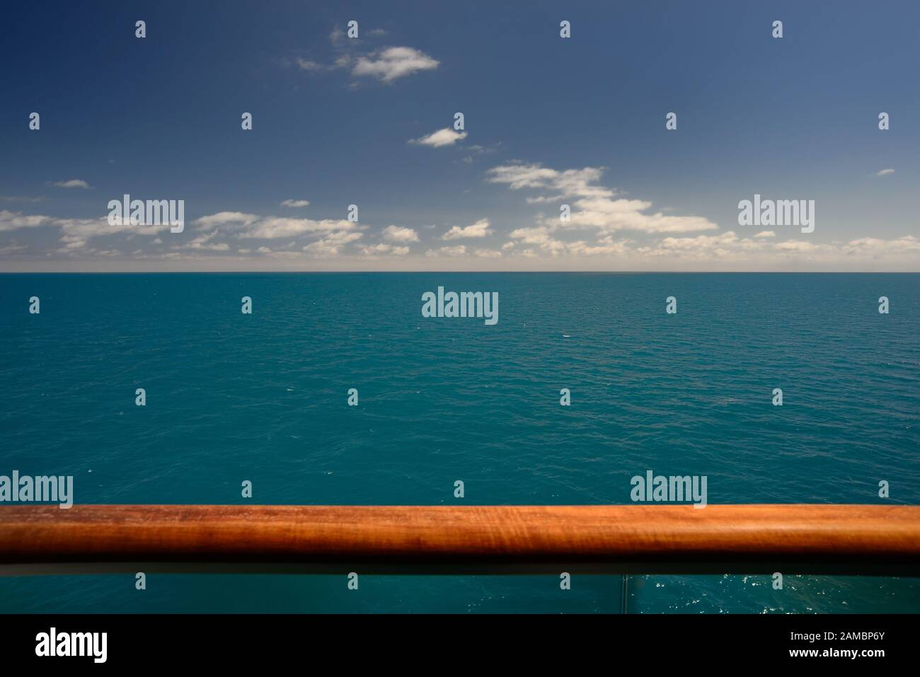 Blue sky, blue sea, and the handrail of a cruise ship. Stock Photo