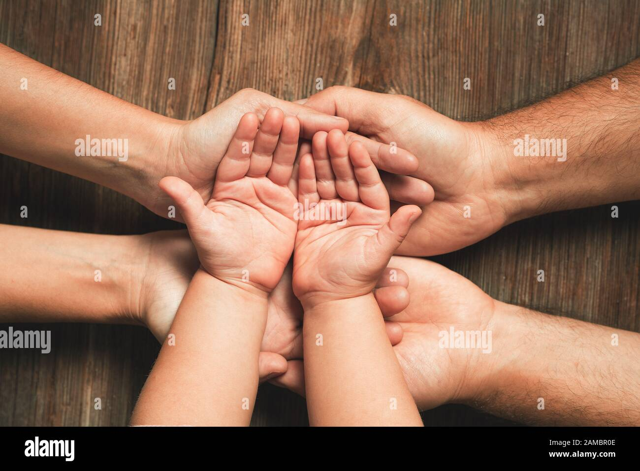 Three hands of family. Love, togetherness, happiness in family concept Stock Photo
