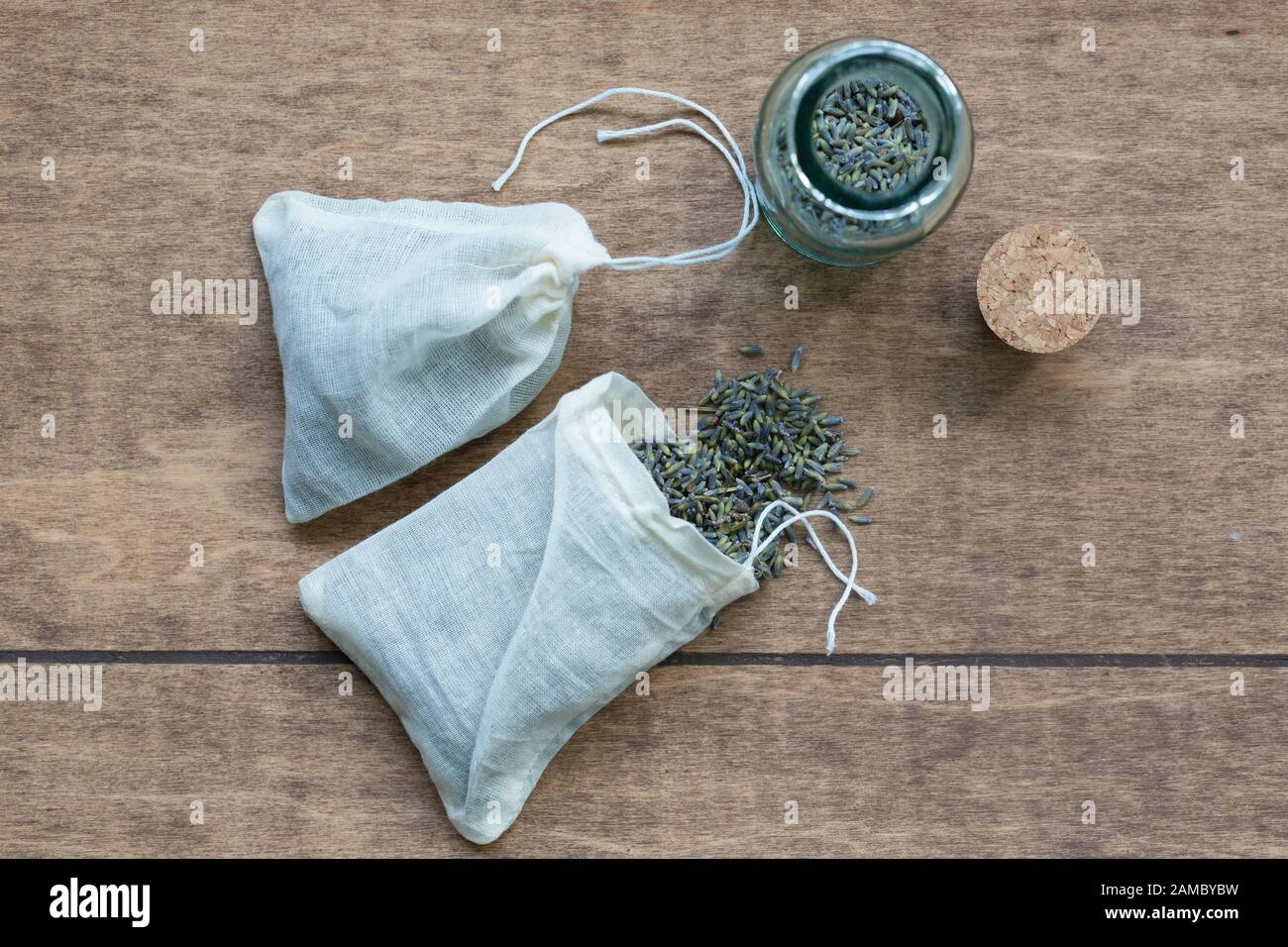 Dried organic lavender flowers in muslin pouches for use in dryer as a replacement for dryer sheets. Stock Photo
