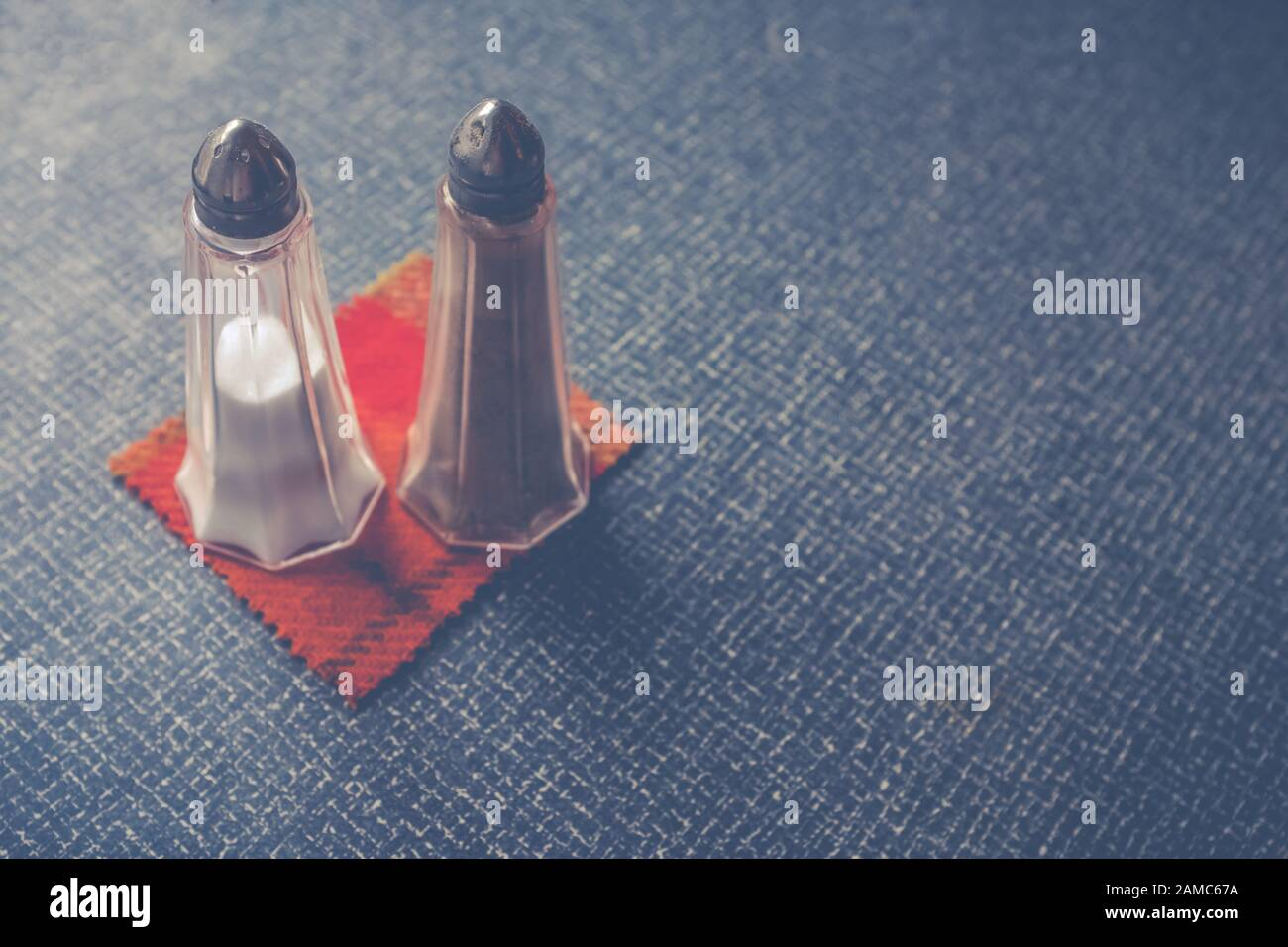 Salt And Pepper Shakers On A Retro Plastic Diner Table With Copy Space Stock Photo