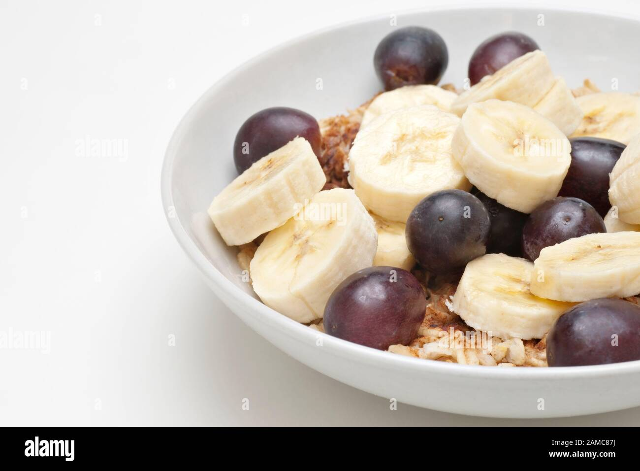 Healthy Low Fat Breakfast Of Hot Oatmeal Banana Slices And