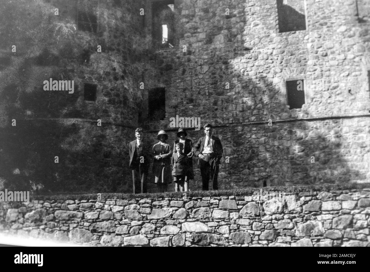 Archive image of a family holiday in front of a ruin, circa 1920s scanned directly from the negative Stock Photo