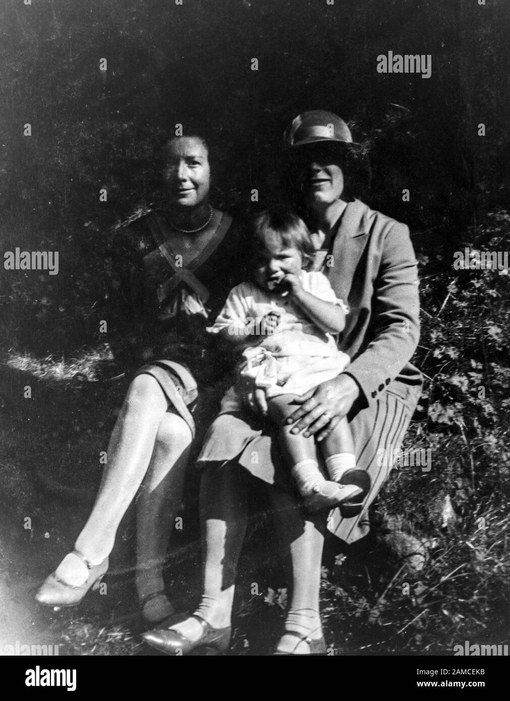 Archive image of two ladies with a toddler, circa 1920s, scanned directly from the negative Stock Photo