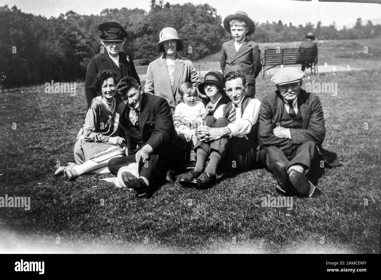 Archive image of a family group outside in a park, circa 1920s scanned directly from the negative Stock Photo
