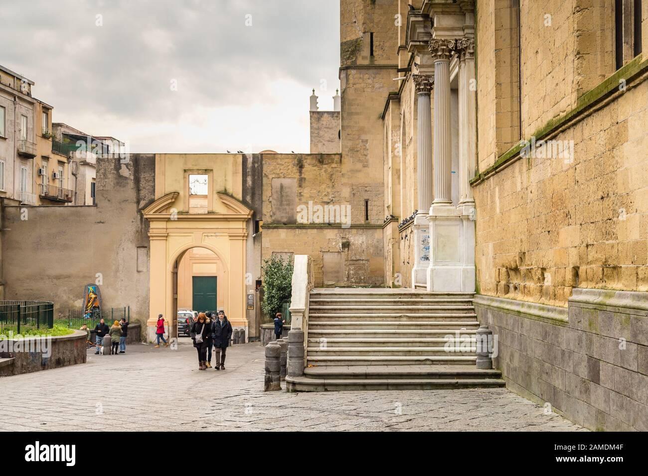 NAPLES, ITALY - JANUARY 4, 2020: tourists visiting THE monumental complex of Santa Chiara Stock Photo
