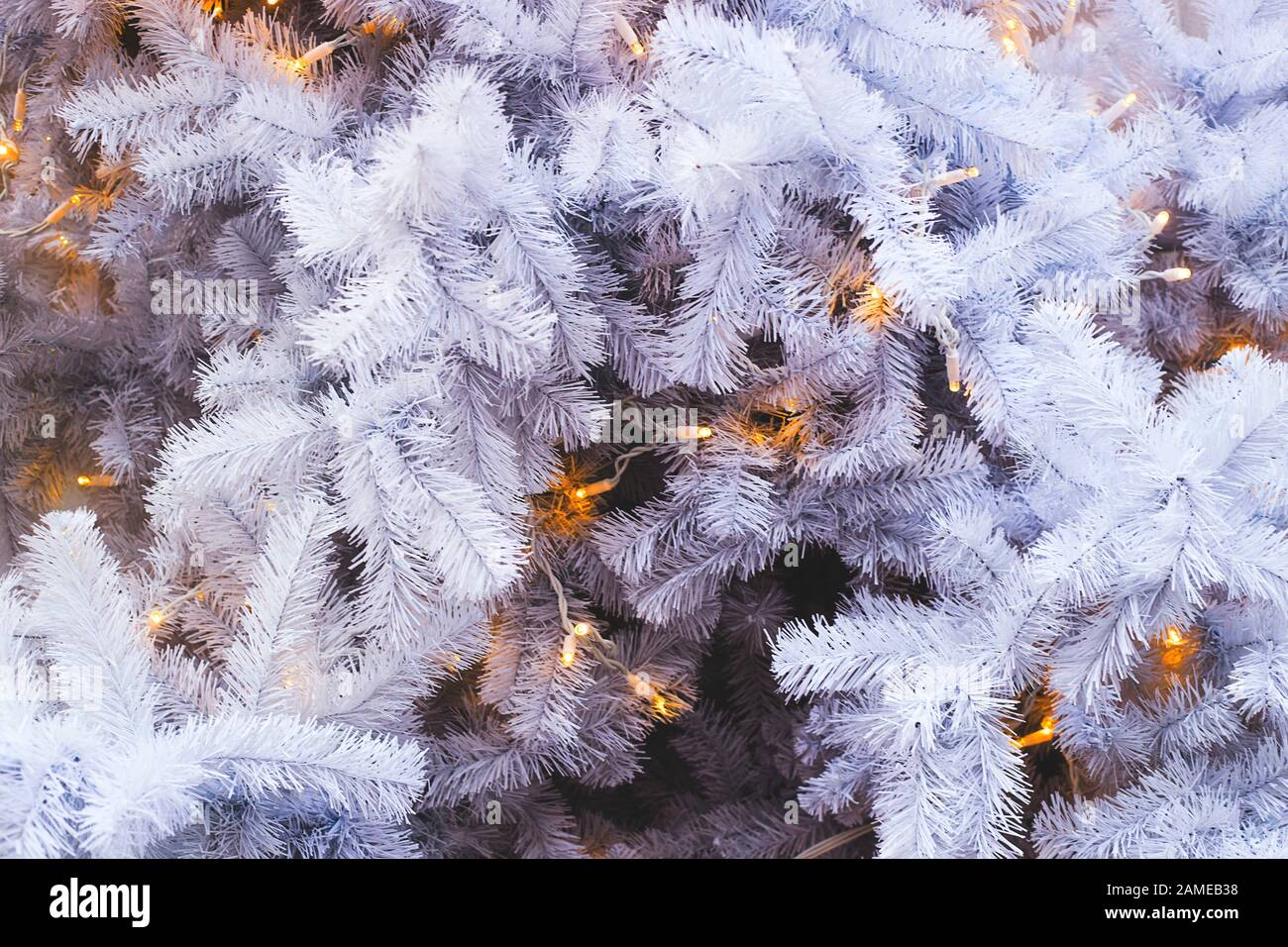 White Branches Of A Fake Plastic Christmas Tree With Lights As A Holiday Decoration No Eco Friendly Decor And Harm To Nature Concept Stock Photo Alamy