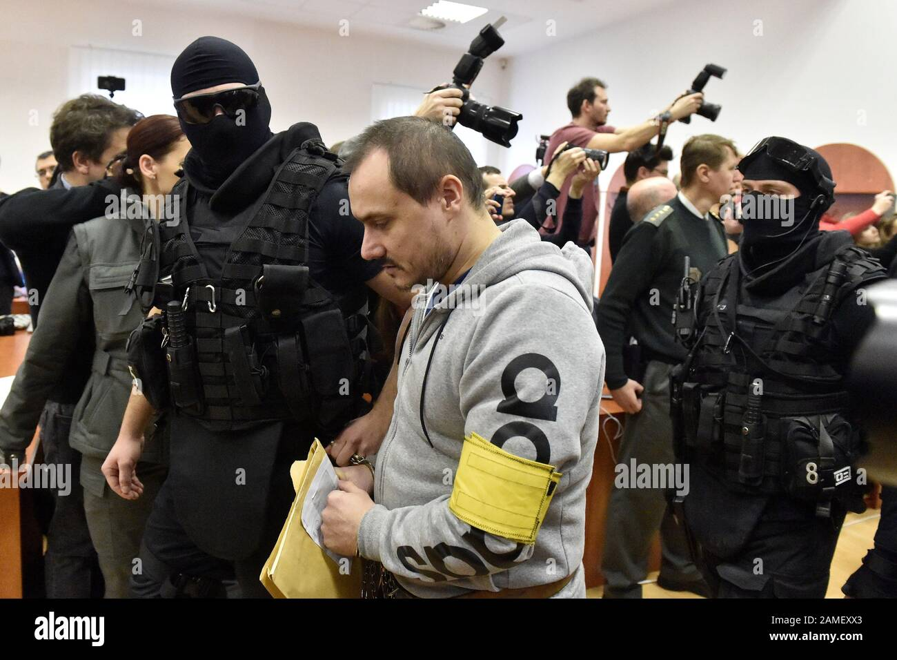 The Heavily Armed Members Of Prison Service Bring Tomas Szabo Into
