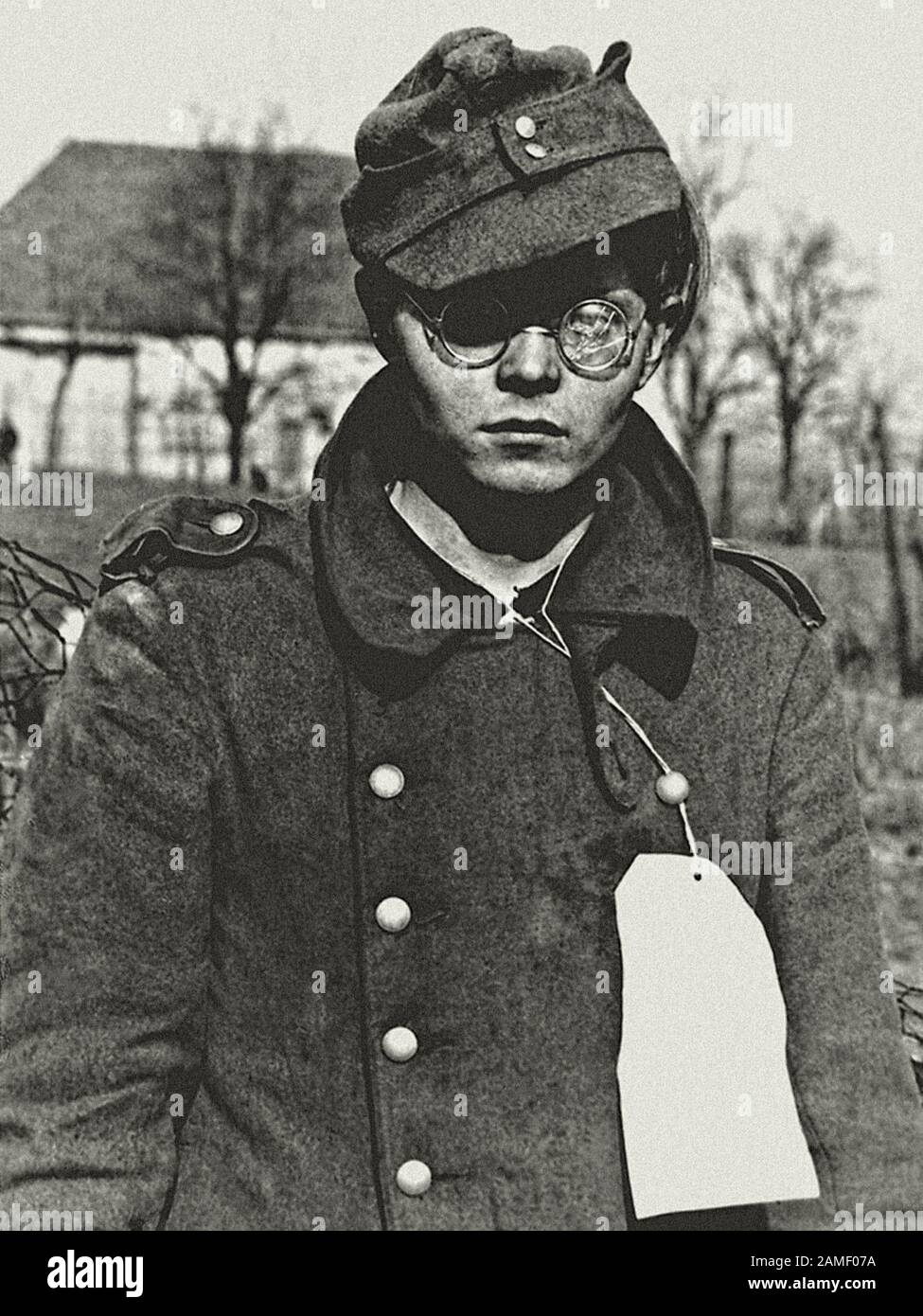 A 19-year-old German soldier captured by allies from the 7th US Army in the French border town of Forbach, Lorraine. France. March 1945 Stock Photo