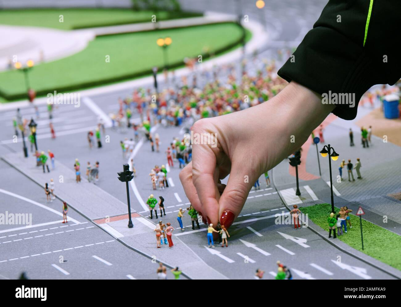 Berlin Germany 13th Jan 2020 A Young Woman Places A Miniature Figure In A Model Of The Loveparade Loveparade Founder Dr Motte Presented His New Project In A Press Conference With The
