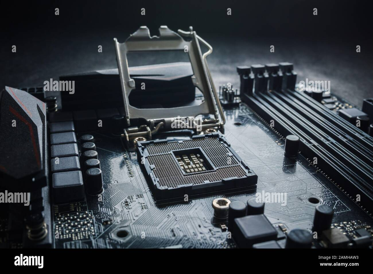 Close-Up of CPU Socket on a Modern Computer Motherboard. Electronic Small Component Details. PC repair or upgrade concept. Stock Photo