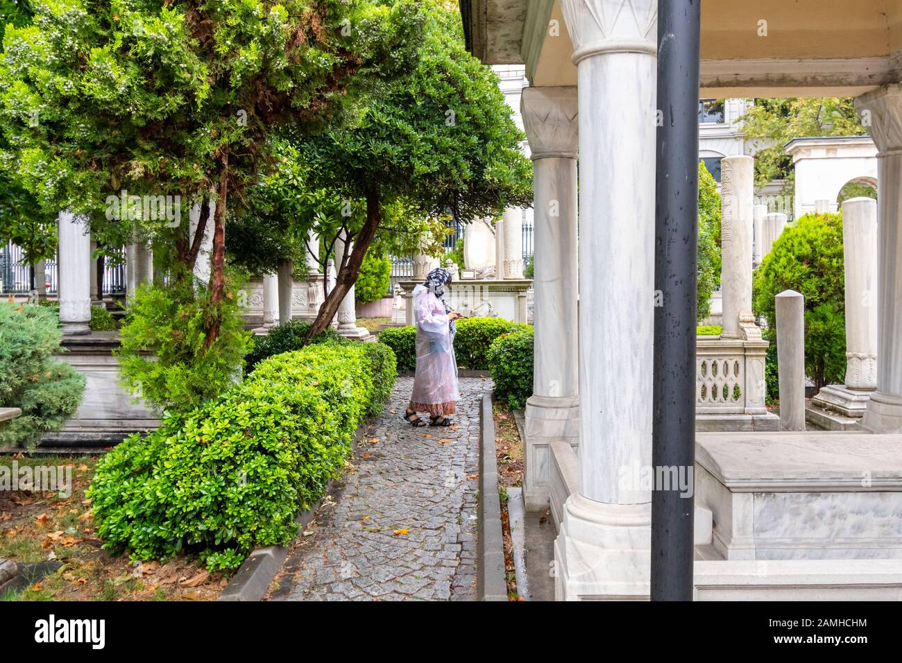 A Muslim woman visits the interior courtyard of the Ahmet Tevfik Paşa Tomb filled with marbled headstones, graves and memorials to Turkey's sultans. Stock Photo