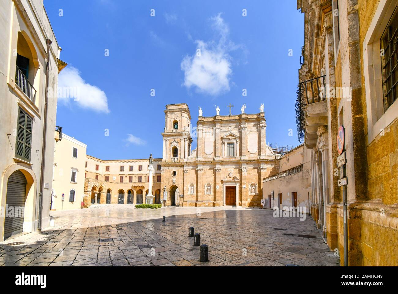 The piazza courtyard in front of St. John the Baptist Church also known as the Duomo Cathedral in the seaside town of Brindisi, Italy. Stock Photo
