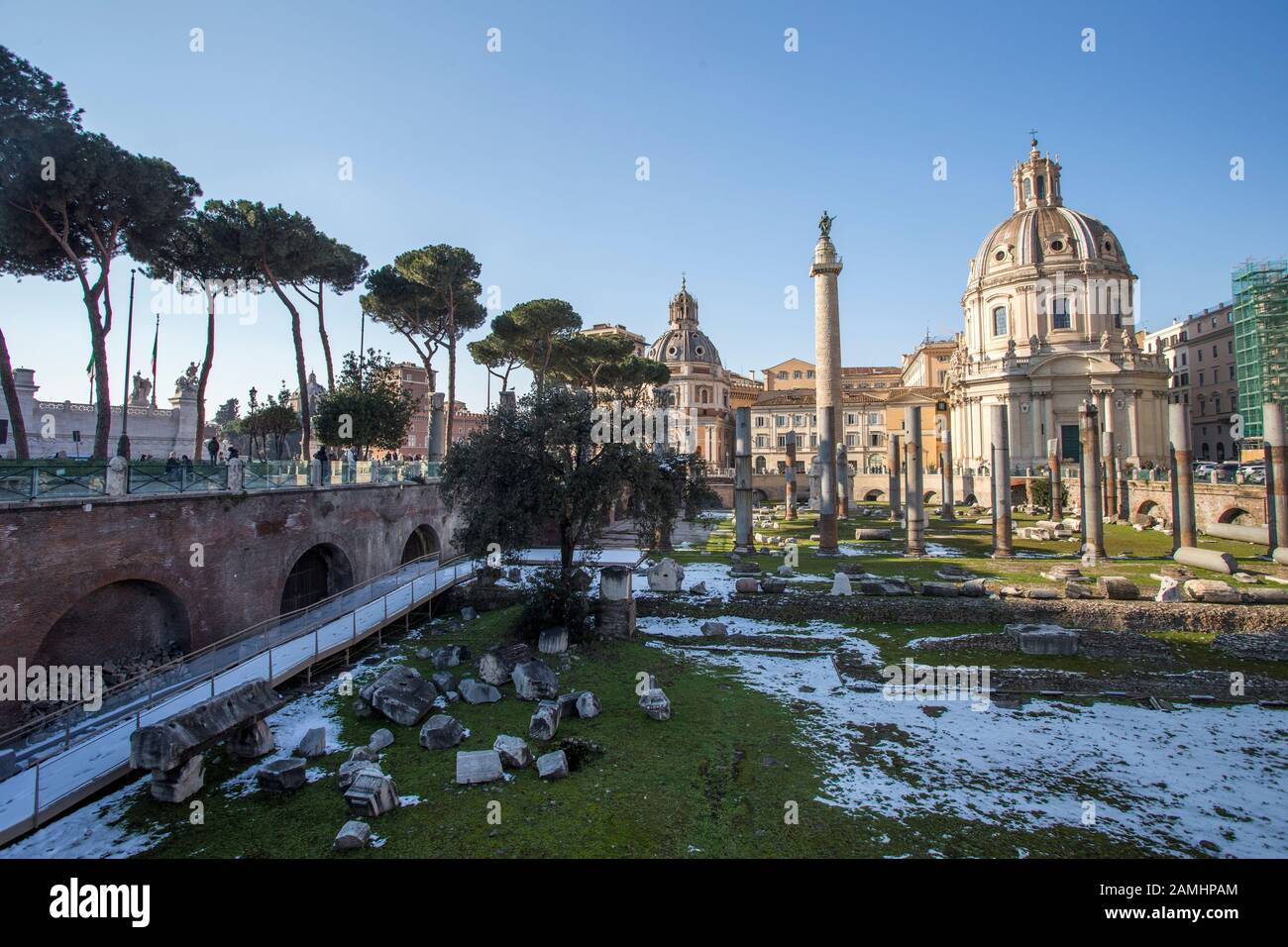 Rome, Italy, February 2018 - Snow covered Rome, winter tourism in capital city of Italy, famous travel destination in winter. Forum Romanum with snow. Stock Photo