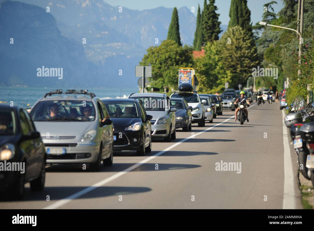 Traffic jam on the shore road Gardesana Occidentaleder on the western side of Lake Garda from Riva del Garda in the north to Desenzano in the south. [automated translation] Stock Photo