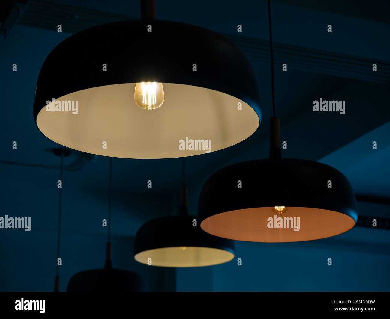 Beautiful Round Modern Ceiling Lamps With Light Bulbs In Dark Blue Room Background Stock Photo Alamy