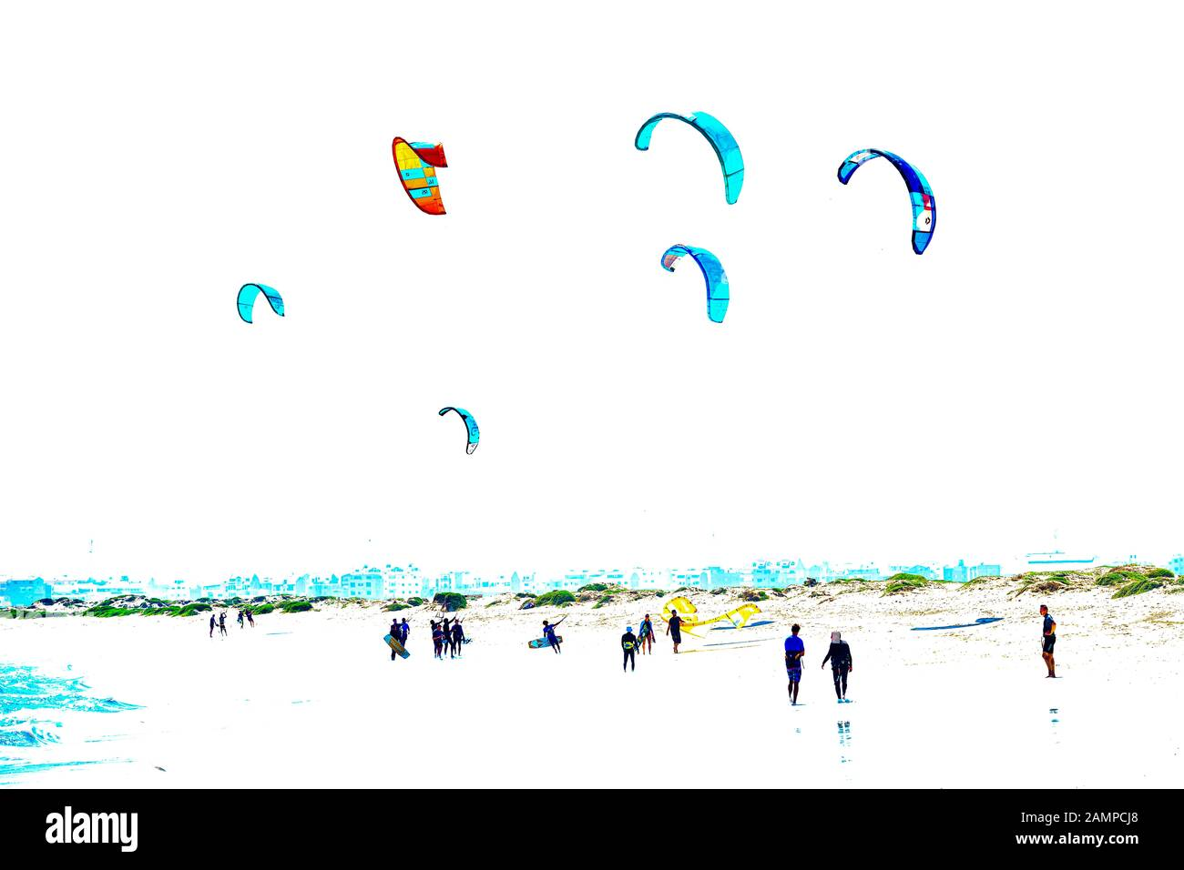 Kitesurfer with colourful sails on the beach, Santa Maria, Sal Island, Cape Verde Stock Photo