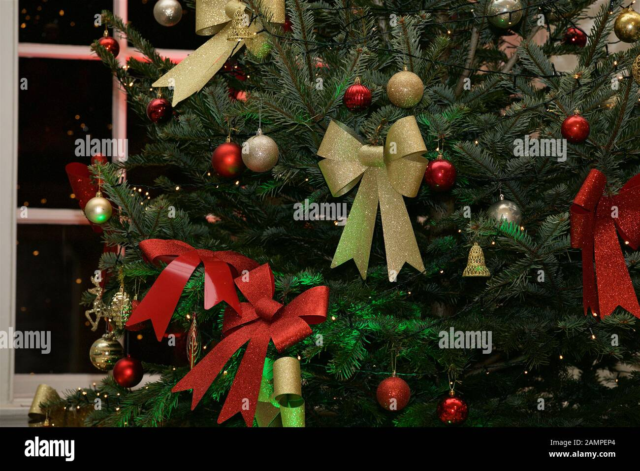 Christmas Background Close Up Shot Of A Decorated Christmas Tree With Ribbons And Baubles Stock Photo Alamy