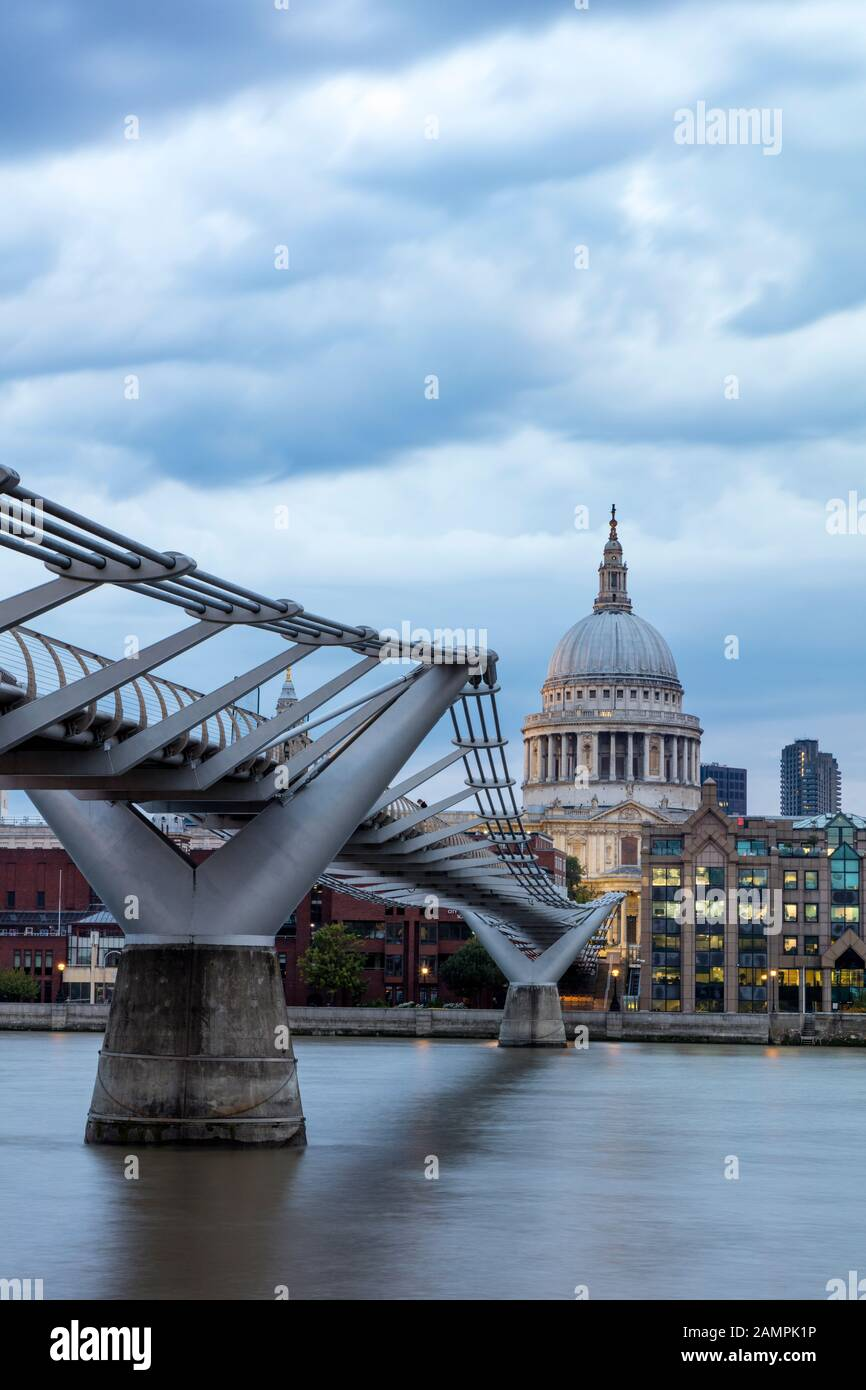 Millennium Bridge over River Thames with dome of St. Paul's Cathedral beyond, London, England, UK Stock Photo