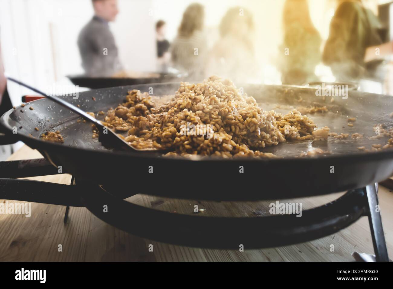Paella pan with traditional Spanish food usually prepared with rice, meat, seafood Stock Photo