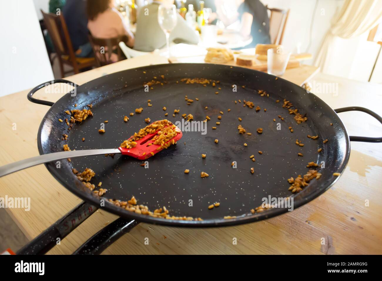 Empty Paella pan with traditional Spanish food usually prepared with rice, meat, seafood Stock Photo