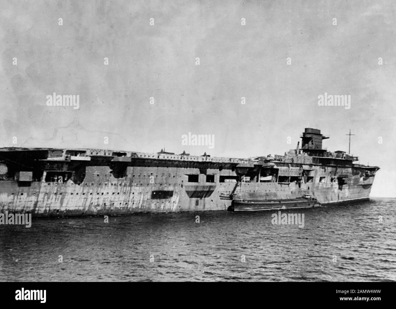 The former German aircraft carrier Graf Zeppelin on 5 April 1947 at Swinemünde (today Świnoujście, Poland) while in Soviet custody. The scuttled carrier had been refloated in March 1946 and was sunk as a target in the Baltic Sea on 16 August 1947. April 1947 Stock Photo