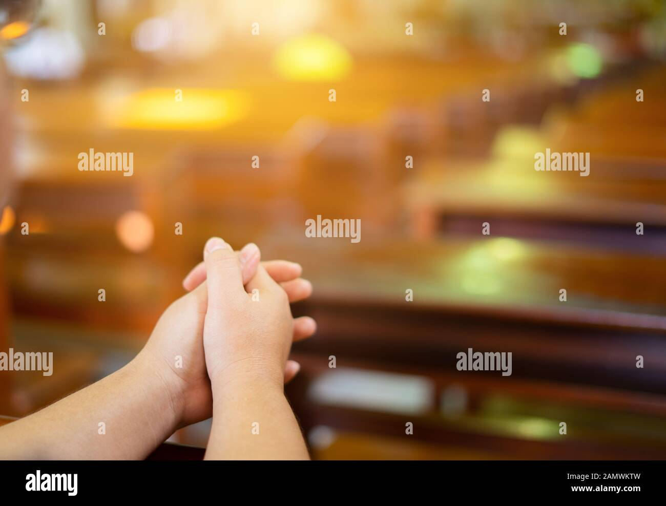 Woman hands are worship christian god while in church. Eucharist Therapy Bless God Helping Repent Catholic Easter Lent Mind Pray. Christian concept ba Stock Photo