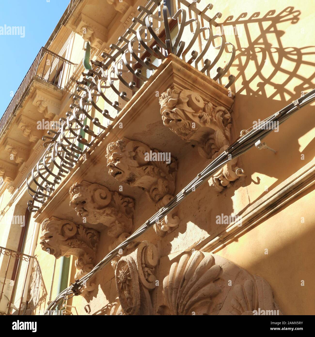 Sculptured balcony brackets. Baroque architecture in Sicily Stock Photo
