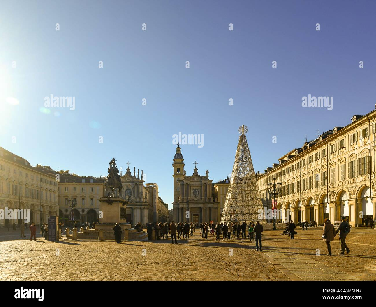 Piazza San Carlo square in the historic centre with people, tourists and the modern Christmas tree on a sunny Christmas day, Turin, Piedmont, Italy Stock Photo