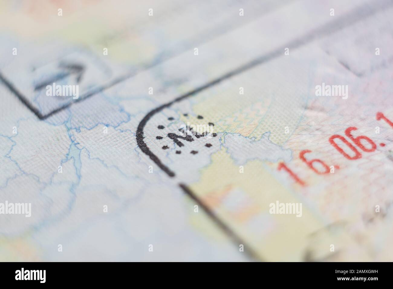 Close-up macro detail of European Union border control customs admission stamp with airplane symbol in focus and Netherlands country sign Stock Photo