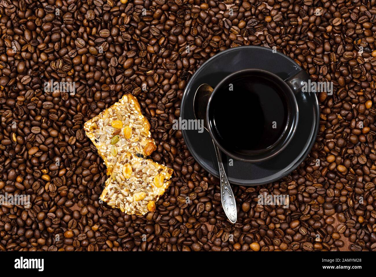 White coffee mug and cookies on the coffee beans background - image Stock Photo