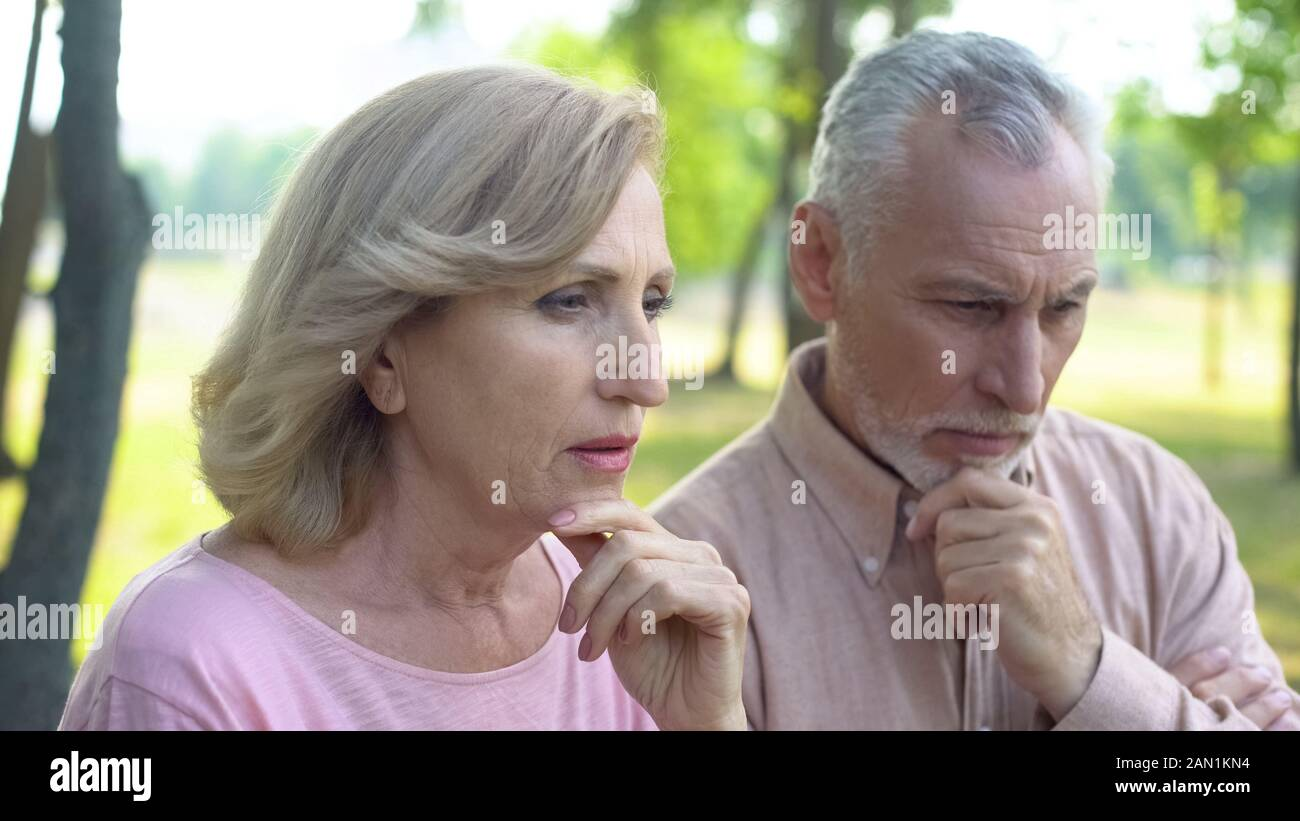 Retired male and female worrying about future, social reform for pensioners Stock Photo