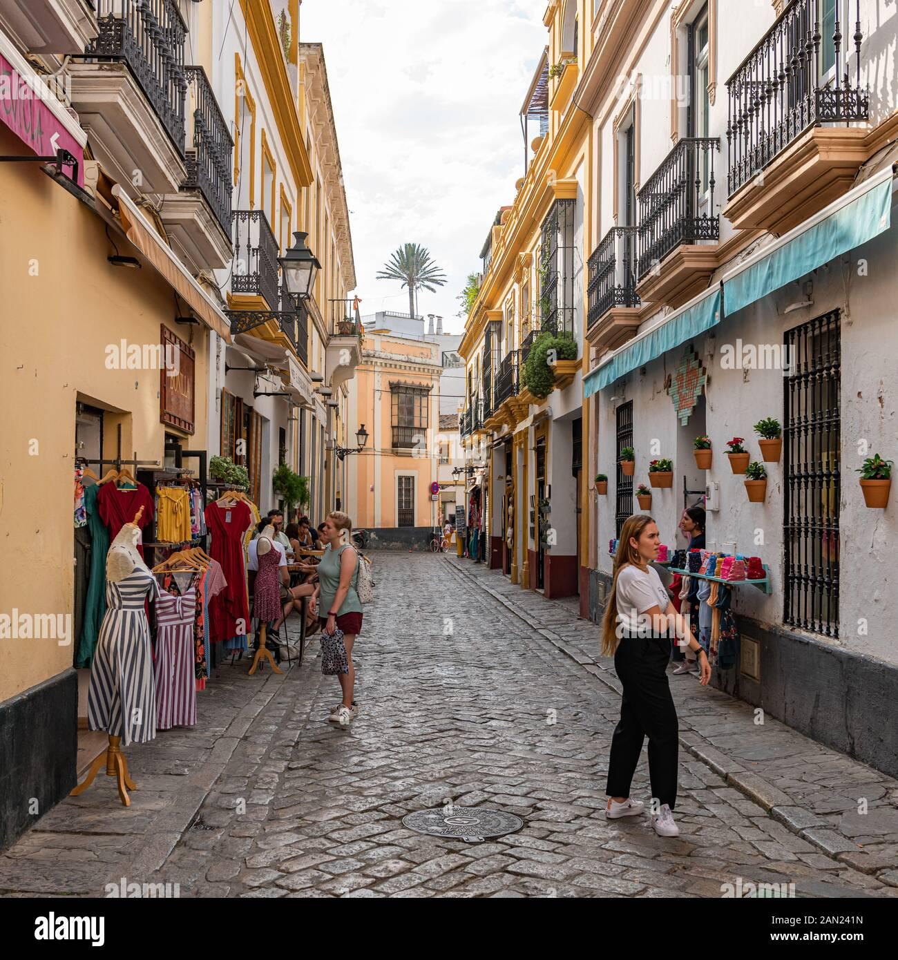 Colourful buildings line the narrow Pasaje de Andreu in Seville's old Jewish Quarter in Santa Cruz Stock Photo