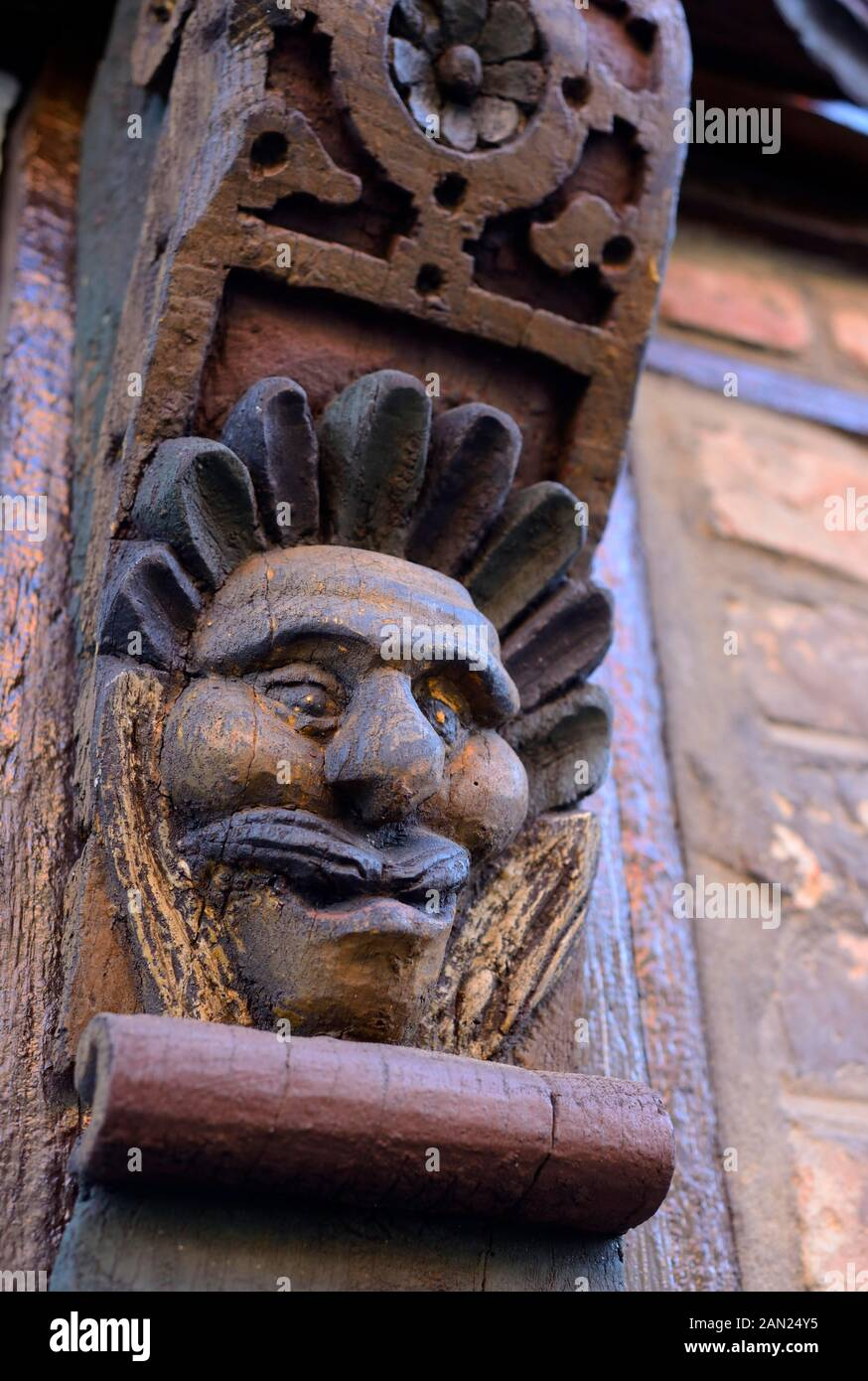 Carved face on wooden beams from Hans Raffns house from the Middle Ages, angel house in Ystad, Scania, Sweden Stock Photo